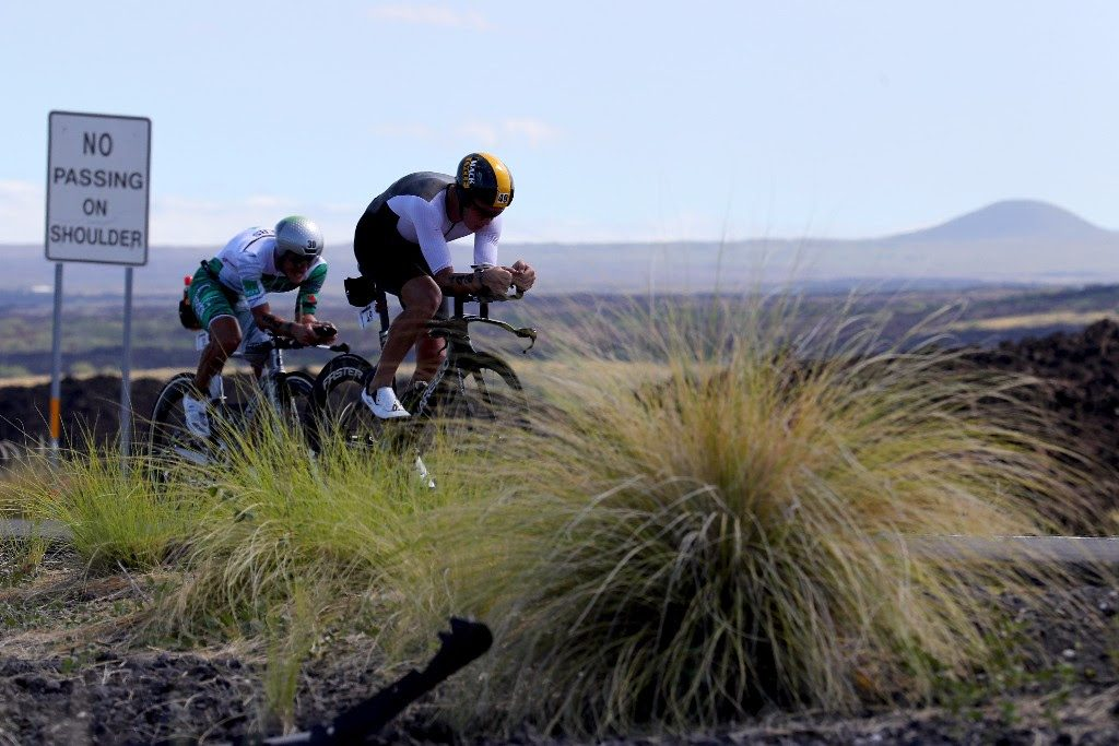 TIME TO FLY: Cameron Wurf of Australia passes Lionel Sanders of Canada on his way to smash Norman Stadler's 2006 IRONMAN World Championship bike course record by more than 5 minutes. (Photo by Tom Pennington/Getty Images for IRONMAN)