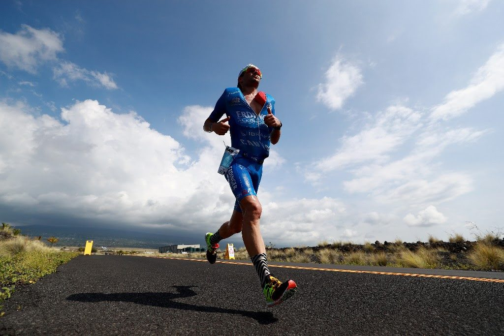 FLYING HIGH: IRONMAN World Championship run course record holder Patrick Lange of Germany floats towards the Natural Energy Laboratory of Hawaii Authority on his way to breaking the course record that had stood since 2011 . (Photo by Tom Pennington/Getty Images for IRONMAN)