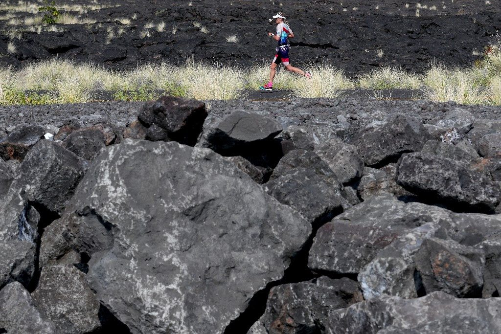 BOULDER DASH: IRONMAN World Championship rookie, Lucy Charles from Great Britain, runs solo along Queen Ka'ahumanu Highway. (Photo by Tom Pennington/Getty Images for IRONMAN)