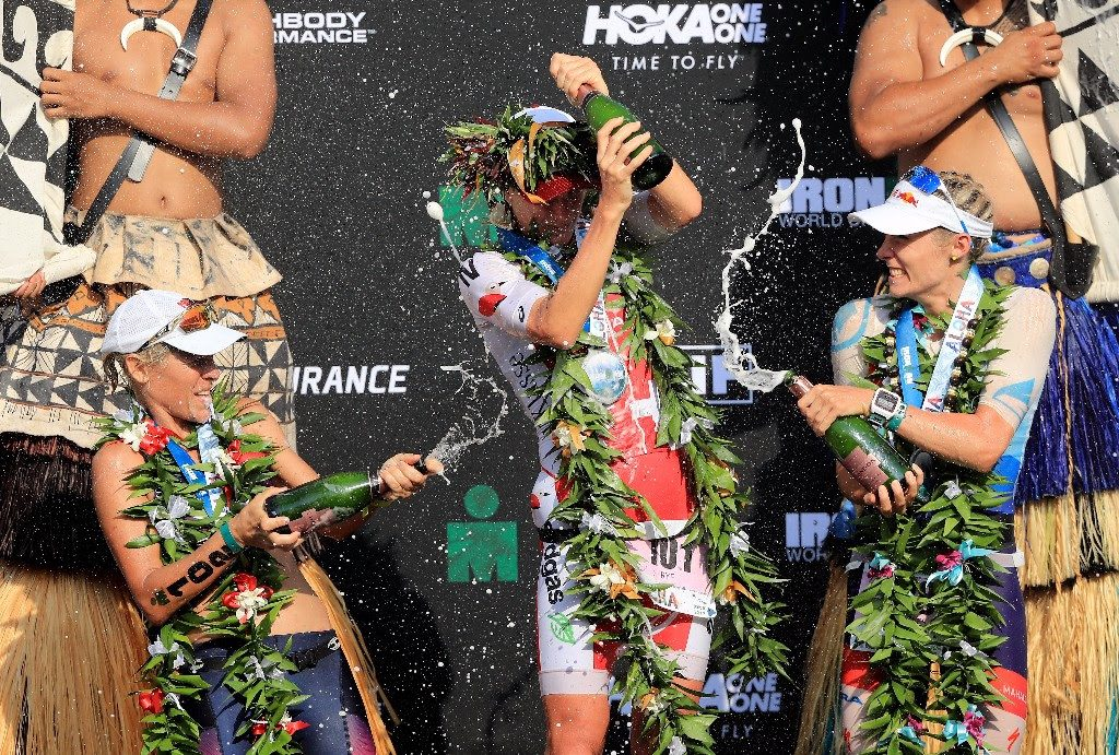 FIZZING: The 2017 IRONMAN World Championship Women's Podium: 1st - Daniela Ryf from Switzerland (center), 2nd - Lucy Charles from Great Britain (right) and 3rd - Sarah Crowley from Australia (left). (Photo by Sean M. Haffey/Getty Images for IRONMAN)
