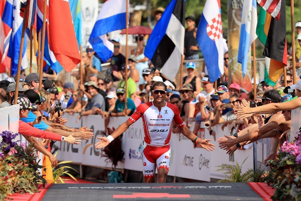 THAT FINISH LINE FEELING: New Zealand's Terenzo Bozzone revels in the crowd support as he crosses the IRONMAN World Championship finish line on Ali'i Drive in Kailua-Kona, Hawai`i. (Photo by Sean M. Haffey/Getty Images for IRONMAN)