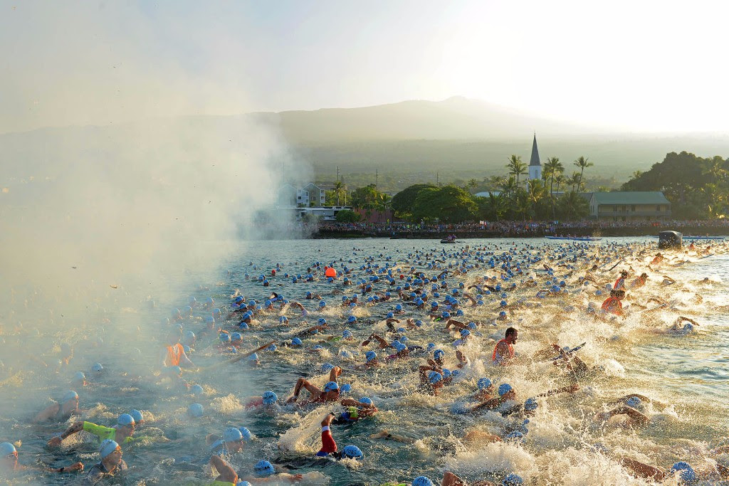 SMOKE & SUNRISE: IRONMAN World Champion age-group men set off as the sun comes up in Kailua-Kona, Hawai'i. (Photo by Donald Miralle/for IRONMAN)
