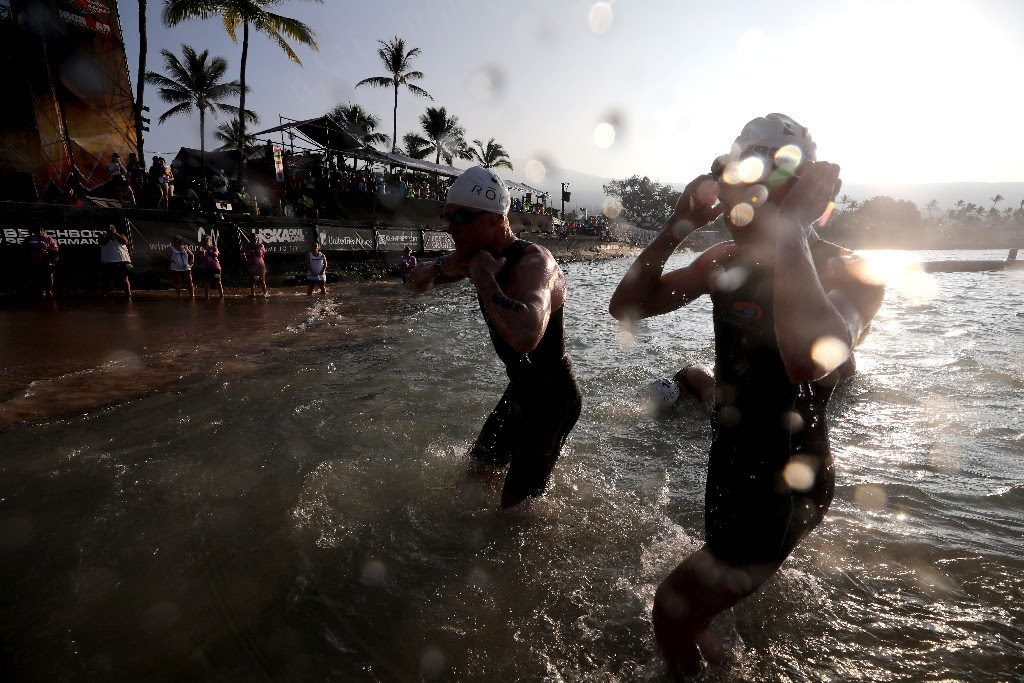 FIRST SIGHT: Professional male swimmers exit the water at Kailua-Kona's iconic Dig Me Beach in front of thousands of spectators during the IRONMAN World Championship on October 14, 2017. (Photo by Tom Pennington/Getty Images for IRONMAN)