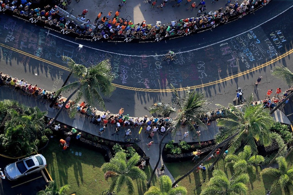 SPECTACULAR LINE UP: Thousands of spectators and messages of support line the streets of Kailua-Kona at the start of the 112-mile bike course at the 2017 IRONMAN World Champion. (Photo by Sean M. Haffey/Getty Images for IRONMAN)